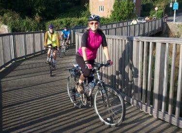 Cyclists on a bridge