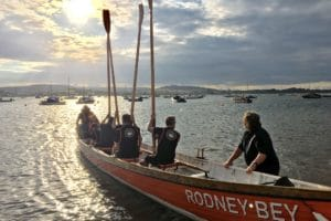 a rowing boat and crew