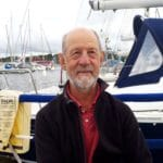 Man standing in front of a harbour