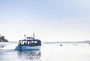 RSPB boat out on the water with passengers